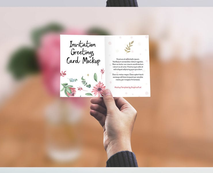 Greeting card in hand mockup psd engine templates
